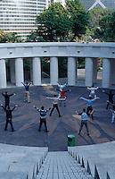 People practicing tai chi in Hong Kong Park, Hong Kong, China.