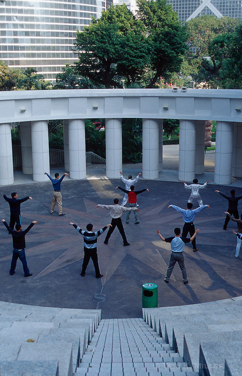 People practicing tai chi in Hong Kong Park, Hong Kong, China.