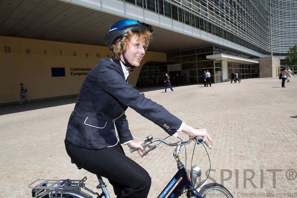 BRUSSELS - BELGIUM - 29 MAY 2010 -- Connie Hedegaard, EU-Commissioner for Climate, on her bicycle at the European Commission HQ, Berlaymont. PHOTO: ERIK LUNTANG / INSPIRIT Photo.