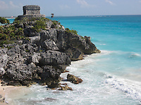 El Castillo of Tulum sets perched upon a 40 ft cliff along the east coast of the Yucatán Peninsula on the Caribbean Sea in Mexico.