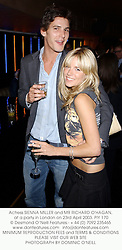 Actress SIENNA MILLER and MR RICHARD O'HAGAN,  at a party in London on 23rd April 2003.	PIY 170