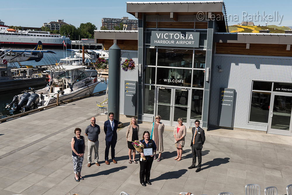 Kelsey Linning of Harbour Air Floatplanes is presented as the winner for outstanding service by the Victoria Hospitality Awards Program.