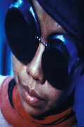 close up of a woman welder's face with safety goggles
