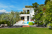 beautiful white house with swimming pool, summer day