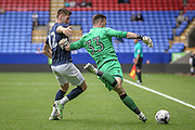 Mark Howard (Bolton Wanderers) clears the ball on the sideline under pressure from Paul Gallagher (Preston North End) during the Pre-Season Friendly match between Bolton Wanderers and Preston North End at the Macron Stadium, Bolton, England on 30 July 2016. Photo by Mark P Doherty.