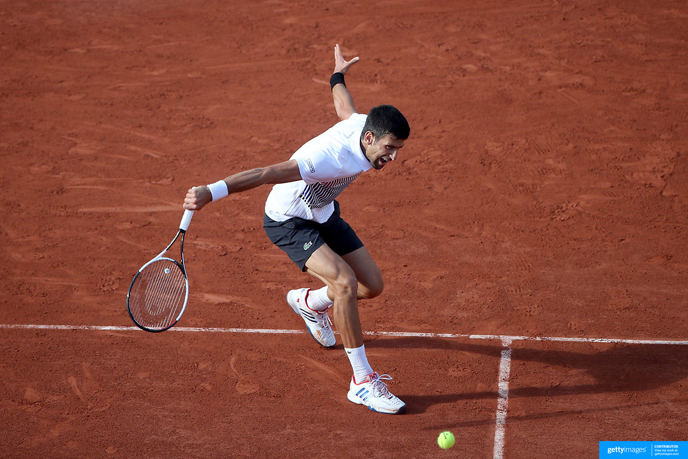2017 French Open Tennis Tournament - Day Eight.  Novak Djokovic of Serbia in action against Albert Ramos-Vinolas of Spain on Philippe-Chatrier Court during the Men's Singles round four match at the 2017 French Open Tennis Tournament at Roland Garros on June 4th, 2017 in Paris, France.  (Photo by Tim Clayton/Corbis via Getty Images)