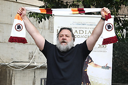 "Rome, photocall theater show ""Il Gladiatore in concerto"". In the picture: Russel Crowe with the scarf of the football team AS Roma"
