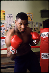 1991:  Boxer Mike Tyson poses for the camera..Mandatory Credit:  Manny Millan/Icon SMI