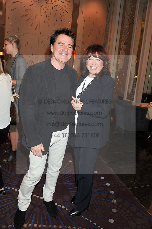 Left to right, CHARLES WORTHINGTON and LYNDA LA PLANTE at a tea party to held at The Langham Hotel, Portland Place, London with tea inspired by Theo Fennell held on 25th April 2013.