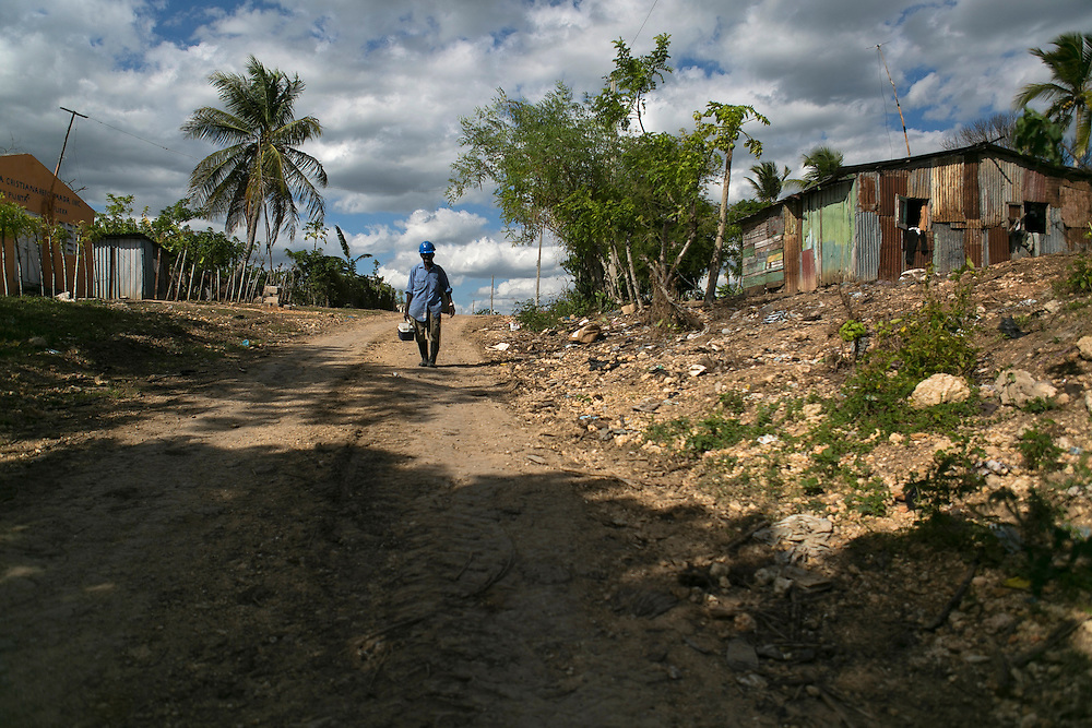 Ramon Amparo, 79, walks two hours to get to the post where he guards the pump that waters the sugar cane in the fields surrounding Batey Punta Afuera, Dominican Republic on Wednesday, Aug. 19, 2015. He worked 58 years cutting cane for the State Sugar Council, CEA, a state entity, which ran the sugar mills where the majority of Haitian immigrants worked. <br /> (Michelle Kanaar/ For the Miami Herald)<br /> Publication Date: Oct. 21, 2015