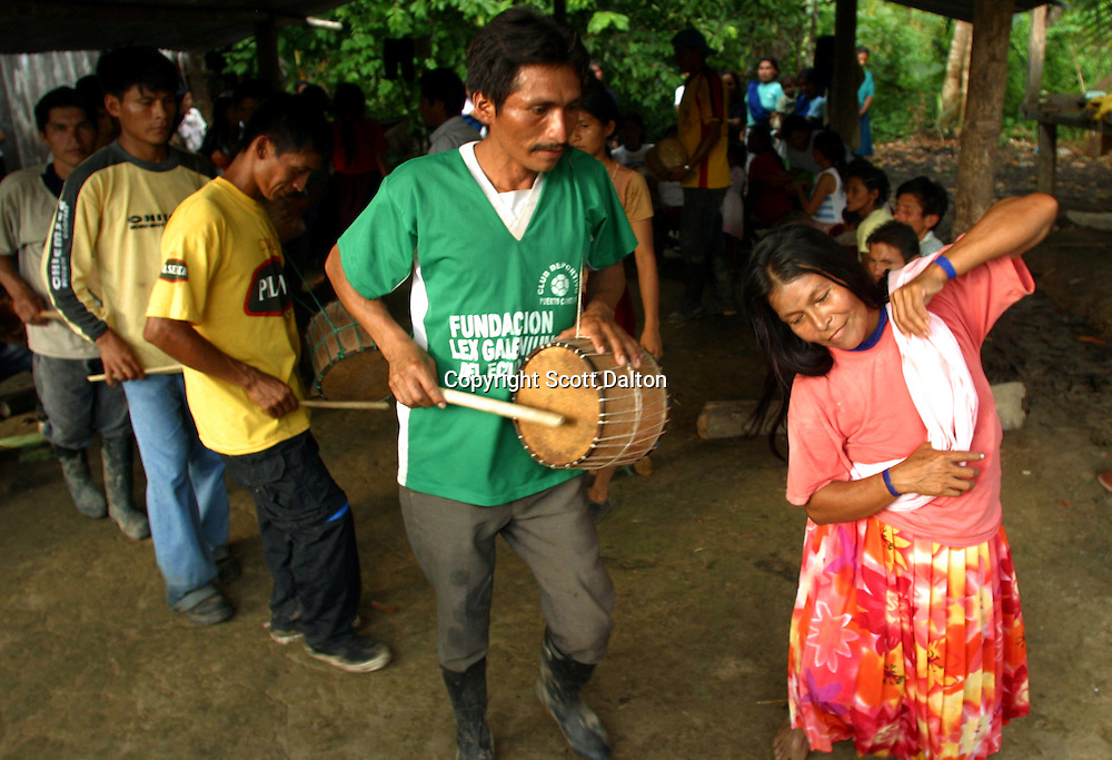 Kichwa Indians play drums and dance at party in Canelos, a small Indian village in Ecuador's Amazon region on Monday, October 27, 2003. The community of Canelos is in favor of oil companies looking for oil on their territory because they say they need jobs. (Photo/Scott Dalton)