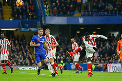 Mame Biram Diouf of Stoke City clears the ball under pressure for Chelsea - Mandatory by-line: Jason Brown/JMP - 31/12/2016 - FOOTBALL - Stamford Bridge - London, England - Chelsea v Stoke City - Premier League