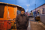 A view to the area with new housing facilities in Konik Camp located in the suburbs of the city of Podgorica, Montenegro. A huge fire in 2012 detroyed a big part of the refugee camp and many of the inhabitants are living now in containers. Portrait of Maljo Krasnici, inhabitant of the Konik Camp.