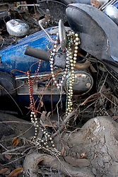 03 Oct, 2005.  New Orleans, Louisiana. Lakeview. Hurricane Katrina aftermath.<br /> The remnants of the lives of ordinary folks, now covered in mud as the flood waters recede. A Harley Davison motorcycle lies trashed in the mud.<br /> Photo; ©Charlie Varley/varleypix.com