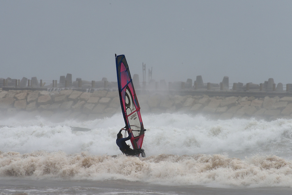 A wind surfer in the Israeli coastal city of Herzliya on January 05, 2018 as a storm hits the country. Photo by Gili Yaari