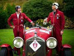 © Licensed to London News Pictures. 13/07/2015. Epsom, UK. FREDERIC GOETTTSCHE BEBERT and his son MICHAEL GOETTTSCHE BEBERT pose with their 1928 Alfa Romeo MM Supercharged before setting off on the race. The start of The Royal Automobile Club 1000 Mile Trial 2015 at Woodcote Park in Epsom, Surrey. The event, which starts and finishes at Woodcote Park, takes a fleet of over 40 classic cars from around the world, through a 1000 mile trial around the UK.  Photo credit: Ben Cawthra/LNP