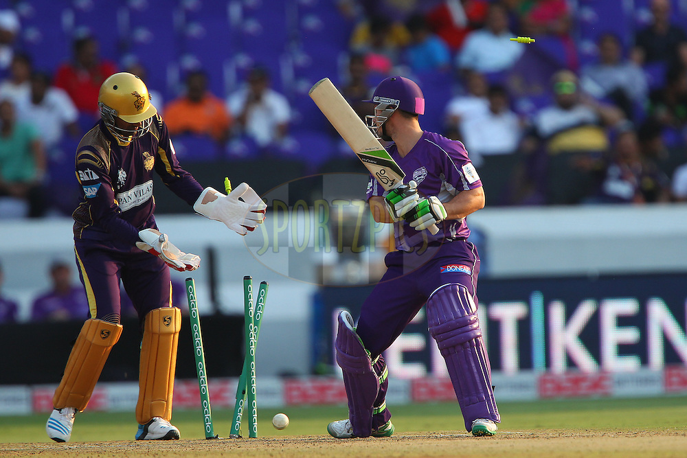 Jon WELLS of the Hobart Hurricanes is bowled by Piyush CHAWLA of the Kolkata Knight Riders  during the first semi final match of the Oppo Champions League Twenty20 between the Kolkata Knight Riders and the Hobart Hurricanes held at the Rajiv Gandhi Cricket Stadium, Hyderabad, India on the 2nd October 2014<br /> <br /> Photo by:  Ron Gaunt / Sportzpics/ CLT20<br /> <br /> <br /> Image use is subject to the terms and conditions as laid out by the BCCI/ CLT20.  The terms and conditions can be downloaded here:<br /> <br /> http://sportzpics.photoshelter.com/gallery/CLT20-Image-Terms-and-Conditions-2014/G0000IfNJn535VPU/C0000QhhKadWcjYs