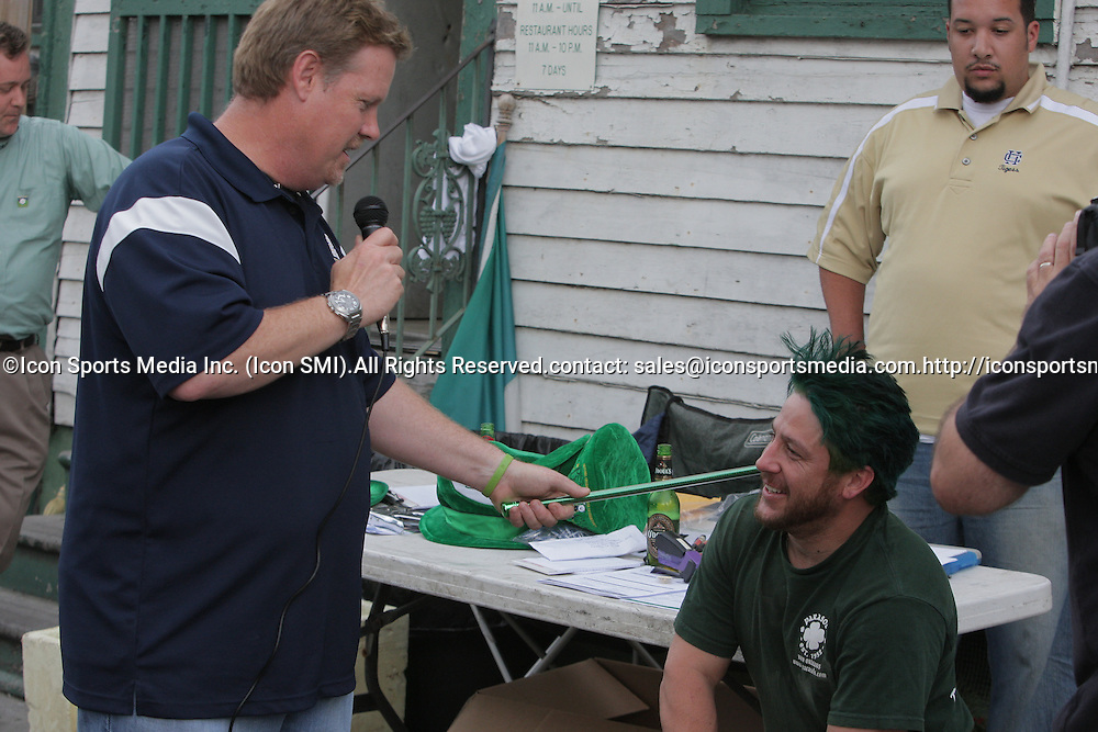 12 March 2009: Volunteer event organizer Dean Arnet anoints Parasol's Bar owner Jeff Carraras into the Knights of the Bald Table for providing seven years of service at St. Baldrick's events during the annual St. Baldrick's charity fund raiser held at Parasol's Bar in the Irish Channel of New Orleans, Louisiana.
