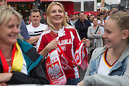 Berlin, Germany - 12.06.2016 <br /> <br /> European Football Championship 2016 fan mile at the Brandenburg Gate. Polish football fans celebrate the 1:0 goal of their team in the Poland vs North Ireland Euro 2016 match at the public viewing on the Stra&szlig;e des 17. Juni in Berlin.<br /> <br /> Fanmeile am Brandenburger Tor zur Fussball-Europameisterschaft 2016. Polnische Fussballfans feiern das 1:0 Tor von ihrem Team im Euro 2016 Spiel zwischen Polen und Nord-Irland beim Public Viewing auf der Stra&szlig;e des 17. Juni.<br /> <br /> Photo: Bjoern Kietzmann
