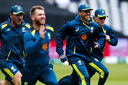 Usman Khawaja of Australia and teammates warm up - Mandatory by-line: Robbie Stephenson/JMP - 06/07/2019 - CRICKET - Old Trafford - Manchester, England - Australia v South Africa - ICC Cricket World Cup 2019 - Group Stage