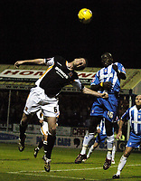 Photo: Olly Greenwood.<br />Colchester United v Hull City. Coca Cola Championship. 28/11/2006. Hull 's Michael Turner and Colchester's George Elokobi