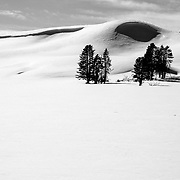 The snow covered hillsides along the Hayden Valley of Yellowstone in winter.