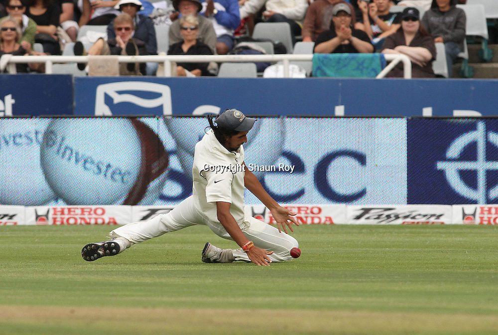 CAPE TOWN, SOUTH AFRICA - 2 January 2011, Ishant Sharma of India makes a sliding stop during day 1 of the 3rd Castle Test between South Africa and India held at Sahara Park Newlands Stadium in Cape Town, South Africa on the 2 January 2011 .Photo by: Shaun Roy