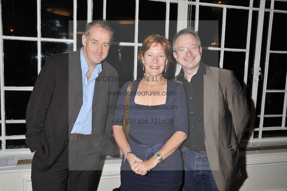 Left to right, JEREMY COOKE, CATHY DEAN Director of Save The Rhino and ROBIN INCE at a dinner in aid of the charity Save The Rhino held at ZSL London Zoo, Regents Park, London on 16th October 2012.