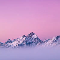 Alpenglow and a dramatic inversion during a heavy winter in the Tetons.