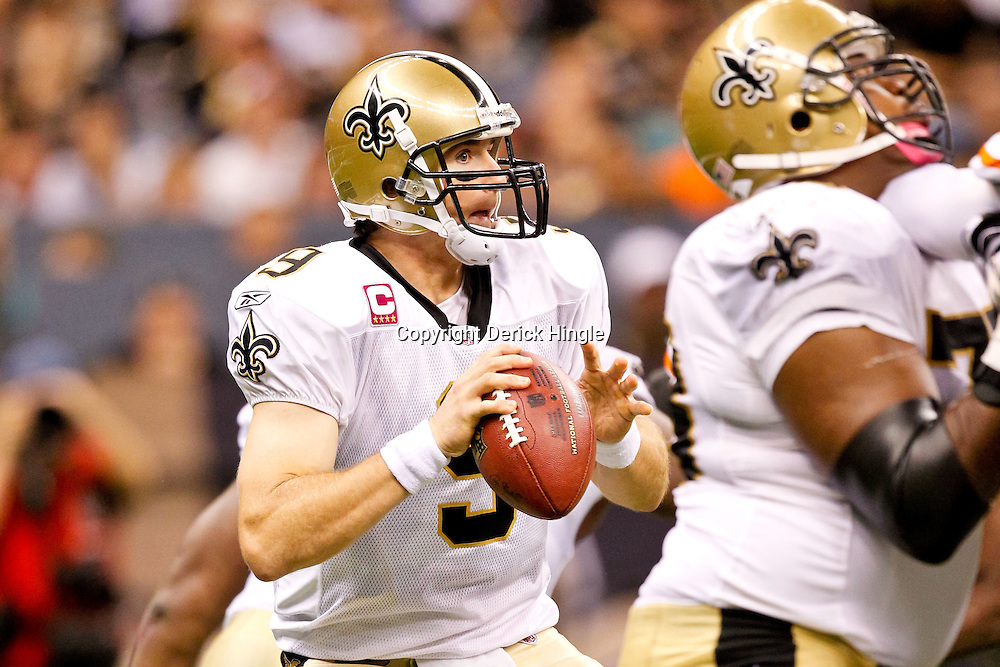 Oct 24, 2010; New Orleans, LA, USA; New Orleans Saints quarterback Drew Brees (9) during a game against the Cleveland Browns at the Louisiana Superdome. The Browns defeated the Saints 30-17.  Mandatory Credit: Derick E. Hingle