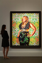 © Licensed to London News Pictures. 23/07/2020. London, UK.  A Sotheby's staff member views a painting titled Alexandra I, Emperor Of Russia (2013) by Kehinde Wiley with an estimate of £150,000-200,000. Works spanning over half a millennium of art history go on display at Sotheby's London ahead of a one-off auction on July 28. Titled 'Rembrandt to Richter', the sale will offer the very best from Old Masters, Impressionist & Modern Art, Modern & Post-War British Art and Contemporary Art – travelling from the Italian Renaissance through to Pop Art. Photo embargoed for usage until 24th July 2020 09:00. Photo credit: Ray Tang/LNP