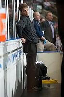 KELOWNA, CANADA - NOVEMBER 9: Scott Hoyer, athletic therapist of the Kelowna Rockets stands on the bench opposite the Edmonton Oil Kings on November 9, 2013 at Prospera Place in Kelowna, British Columbia, Canada.   (Photo by Marissa Baecker/Shoot the Breeze)  ***  Local Caption  ***