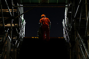 Erle dos Santos, 47, climbs the staircase of the Olympic Tennis Centre during the 2016 Paralympic Games in Rio de Janeiro, Brazil, on Sunday, Sept. 11, 2016. Dos Santos has been working in cleaning services in Rio de Janeiro for 14 years. (Casey Sykes/University of Georgia via AP)