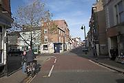 Two men talking in the high street, Lowestoft, Suffolk, England