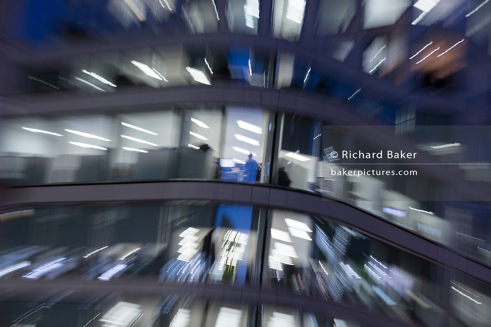 Deliberate blur and zoom on an office worker in generic office buildings in the City of London - the capital's financial district (aka The Square Mile), on 2nd November 2018, in London, England.