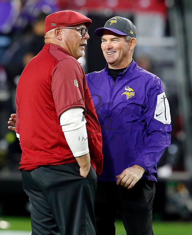 Arizona Cardinals head coach Bruce Arians, left, talks with Minnesota Vikings head coach Mike Zimmer prior to an NFL football game, Thursday, Dec. 10, 2015, in Glendale, Ariz. (AP Photo/Rick Scuteri)