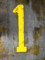 numeral one painted on a weathered surface