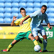 Picture by Alex Broadway/Focus Images Ltd.  07905 628187.30/7/11.Callum Wilson of Coventry City and Adam Drury of Norwich City during a pre season friendly at The Ricoh Arena, Coventry.