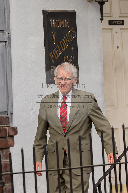 Charleston Mayor Joe Riley departs the Fieldings Funeral home after paying respects to Walter Scott April 10, 2015 in Charleston, South Carolina. The mayor expressed his sorry for the Scott family after he was shot multiple times in the back by police in the neighboring city of North Charleston.