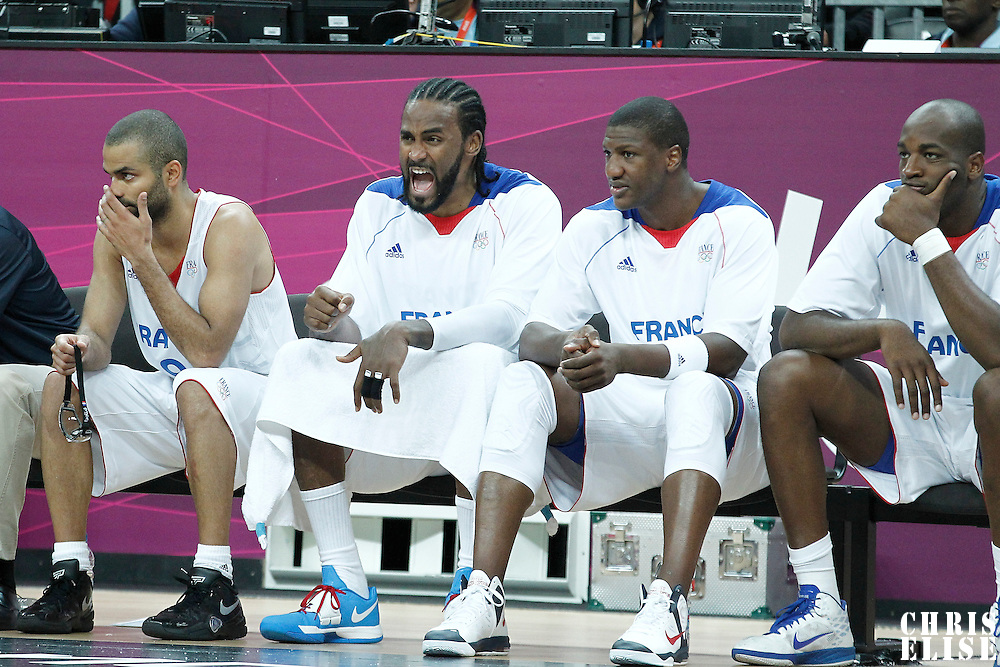02 August 2012: Ronny Turiaf reacts on the bench sitting next to Tony Parker, Yakhouba Diawara and Ali Traore during 82-74 Team France victory over Team Lithuania, during the men's basketball preliminary, at the Basketball Arena, in London, Great Britain.