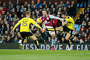 Aston Villa striker Ross McCormack (44) fights for the ball against Burton Albion defender Tom Naylor (15) and Burton Albion midfielder John Mousinho (4) during the EFL Sky Bet Championship match between Aston Villa and Burton Albion at Villa Park, Birmingham, England on 26 December 2016. Photo by Richard Holmes.