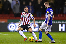 Billy Sharp of Sheffield United challenges Ashley Baker of Sheffield Wednesday - Mandatory by-line: Robbie Stephenson/JMP - 09/11/2018 - FOOTBALL - Bramall Lane - Sheffield, England - Sheffield United v Sheffield Wednesday - Sky Bet Championship