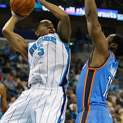 January 24,  2011; New Orleans, LA, USA; New Orleans Hornets guard Marcus Thornton (5) shoots over Oklahoma City Thunder guard James Harden (13) during the first quarter at the New Orleans Arena. Mandatory Credit: Derick E. Hingle