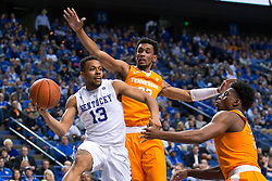 Kentucky guard Isaiah Briscoe, left, looks for an open teammate in the second half.<br /> <br /> The University of Kentucky hosted the University of Tennessee, Thursday, Feb. 18, 2016 at Rupp Arena in Lexington .
