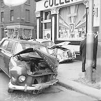 Destroyed cars in the aftermath of the Nelson's Pillar explosion in Dublin. March 8, 1966. (Part of the Independent Newspapers/NLI Collection)