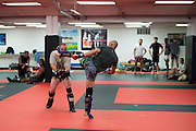 """UFC welterweight Donald """"Cowboy"""" Cerrone of Colorado lands a head kick during sparing at Jackson Wink MMA in Albuquerque, New Mexico on June 9, 2016."""
