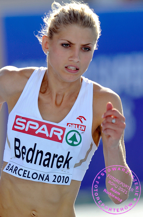 AGATA BEDNAREK (POLAND) COMPETES IN THE WOMEN'S 400 METERS QUALIFICATION DURING THE 2010 EUROPEAN ATHLETICS CHAMPIONSHIPS AT OLYMPIC STADIUM IN BARCELONA, SPAIN...SPAIN , BARCELONA , JULY 28, 2010..( PHOTO BY ADAM NURKIEWICZ / MEDIASPORT )..PICTURE ALSO AVAIBLE IN RAW OR TIFF FORMAT ON SPECIAL REQUEST.