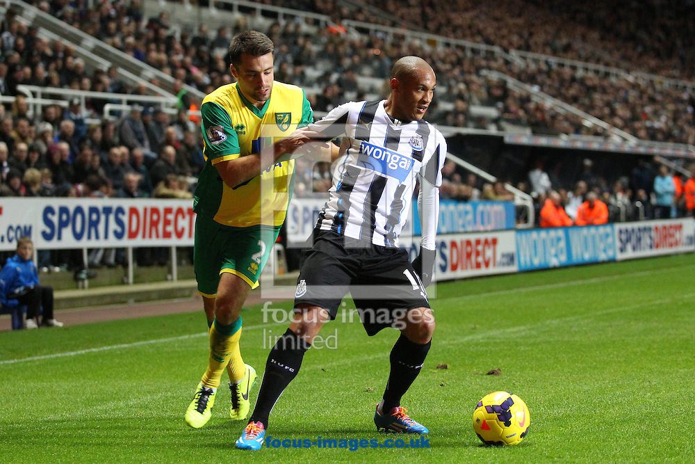 Picture by Paul Chesterton/Focus Images Ltd +44 7904 640267<br /> 23/11/2013<br /> Russell Martin of Norwich and Yoan Gouffran of Newcastle in action during the Barclays Premier League match at St. James's Park, Newcastle.