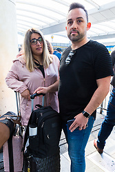 Clearly upset Ana Borgas, 35 and partner Joao Ribeiro, 40, are left tearful after their diving holiday to the Red Sea celebrating Ana's remission from Cancer, is cancelled. Travel company Thomas Cook has ceased trading after failing to come to a deal with its bankers and creditors, leaving tens of thousands of travellers unable to depart on their holidays from South Terminal at Gatwick Airport, and a massive repatriation exercise to return holidaymakers from destinations all over the world. London Gatwick Airport, September 23 2019.
