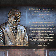 The George M. Steinbrenner III plaque at Monument Park, an open-air museum located at the new Yankee Stadium containing a collection of monuments, plaques, and retired numbers honoring distinguished members of the New York Yankees. New York, USA. Photo Tim Clayton